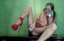 Kitty Purrz masturbating dressed as schoolgirl