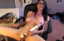 Hottie with sexy glasses playing with sex toys for you