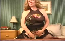 Horny mature slut toying her pussy